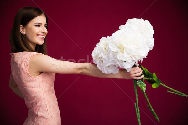 Сток-фото: улыбаясь · очаровательный · женщину · цветы · розовый