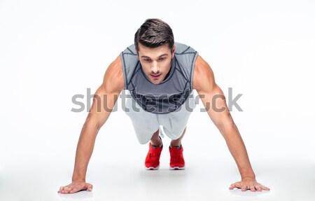Sports man doing push ups Stock photo © deandrobot