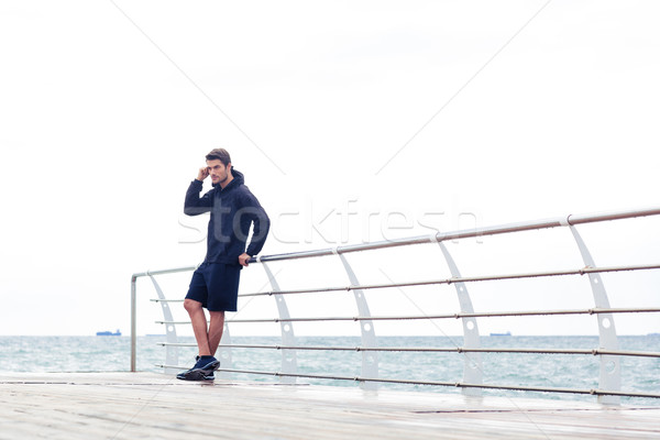 Yakışıklı spor adam ayakta açık havada portre Stok fotoğraf © deandrobot