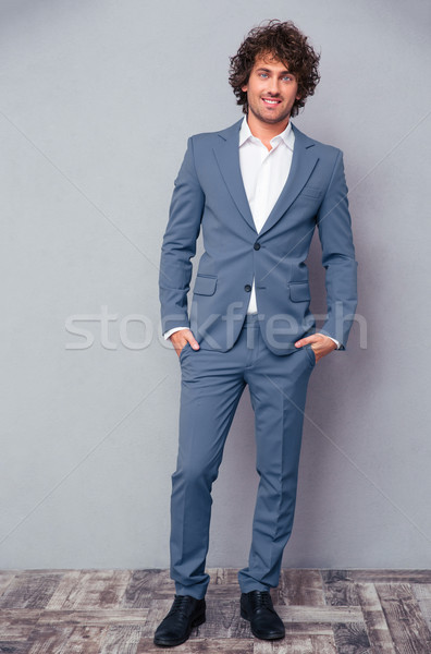 Full length portrait of a happy businessman Stock photo © deandrobot