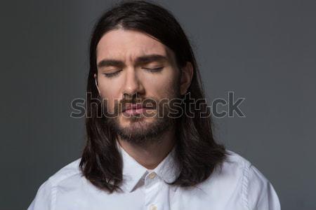 задумчивый человека борода длинные волосы глядя камеры Сток-фото © deandrobot