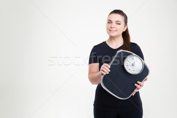Boldog kövér nő tart gép portré Stock fotó © deandrobot