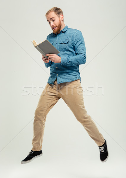 Concept photo of a young man hurry studying Stock photo © deandrobot