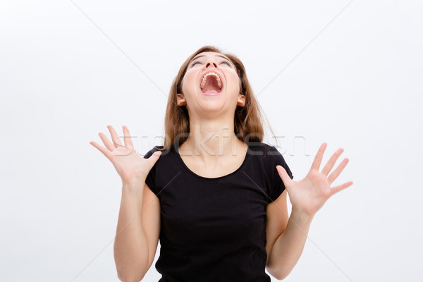 Crazy hysterical young woman screaming and  looking up Stock photo © deandrobot