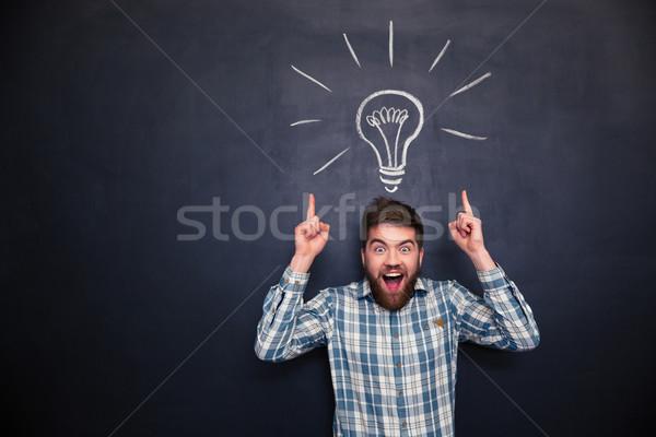 Surpreendido homem indicação para cima tanto mãos Foto stock © deandrobot