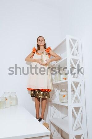 вид сзади портрет Sexy домохозяйка Постоянный изолированный Сток-фото © deandrobot