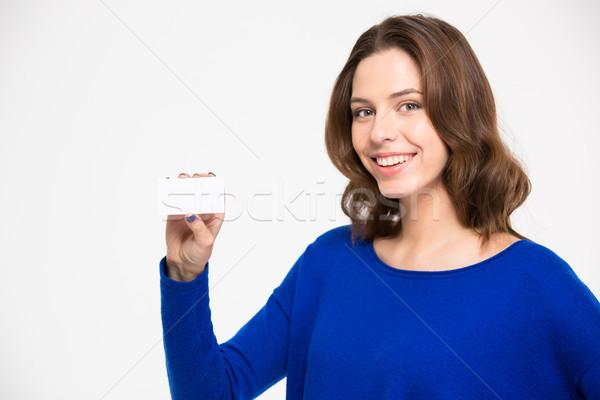Genç kadın boş kart gülen beyaz Stok fotoğraf © deandrobot
