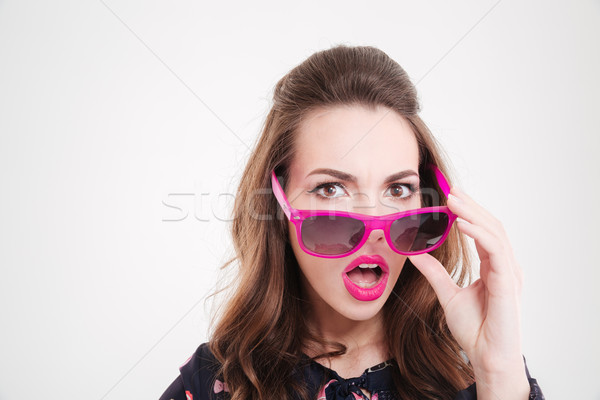 Surprised pretty young woman in sunglasses with opened mouth Stock photo © deandrobot