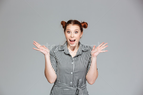 Izgatott boldog lány felemelt kezek áll kiált portré Stock fotó © deandrobot