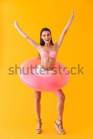 молодые красивая женщина розовый купальник синий изолированный Сток-фото © deandrobot