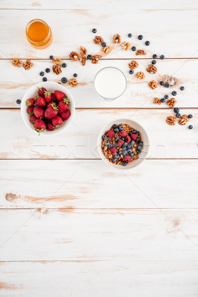 Cereals with berries, strawberry, walnuts and honey Stock photo © deandrobot