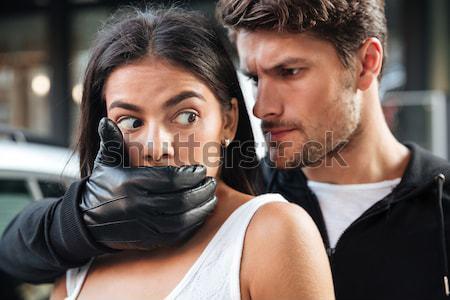 Rabló fedett száj nő fegyver kint Stock fotó © deandrobot