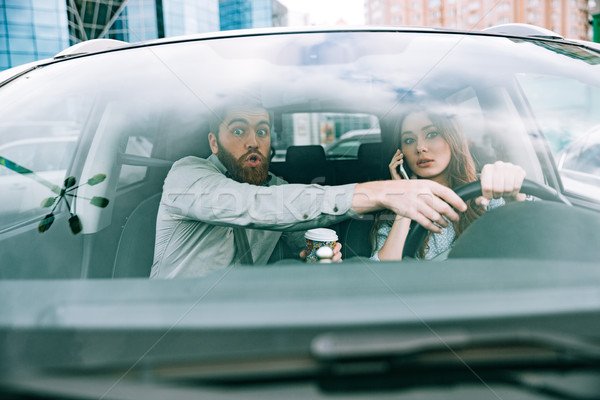 Front photo of couple in car Stock photo © deandrobot