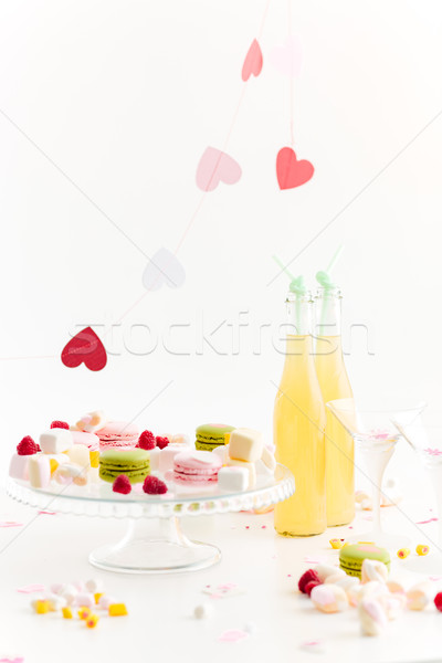 Two glasses, sweets, lemonade and decorations with hearts Stock photo © deandrobot