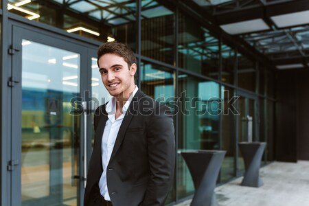 Young business man near the office Stock photo © deandrobot