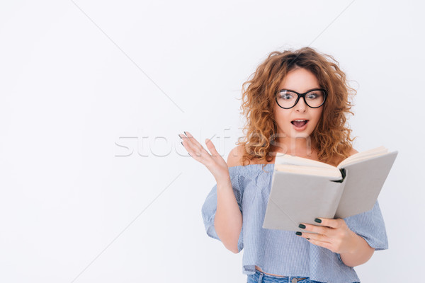 Woman in singlet and glasses reading book Stock photo © deandrobot