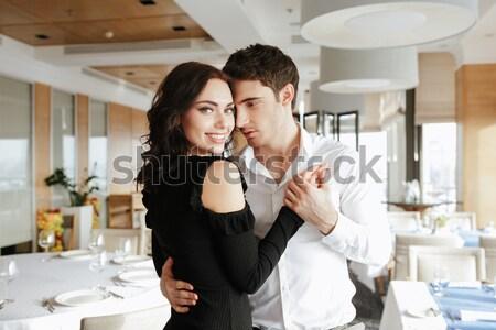 Tendre couple baiser potable vin rouge cuisine Photo stock © deandrobot