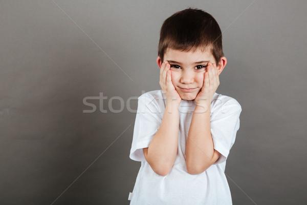 Triste cute piccolo ragazzo piedi mani Foto d'archivio © deandrobot