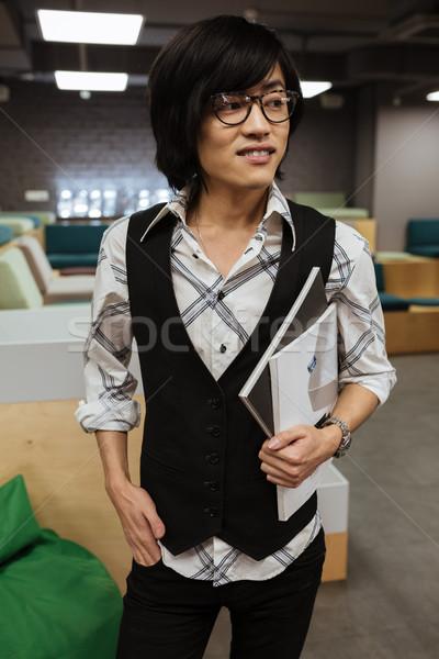 Asian człowiek okulary kurtka shirt Zdjęcia stock © deandrobot