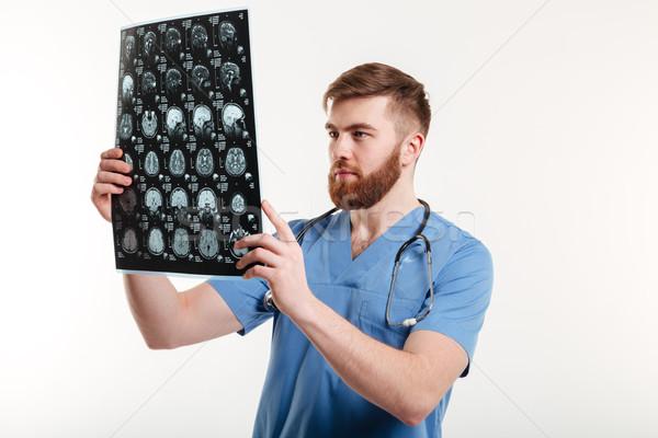 Portret jonge medische arts scannen geïsoleerd Stockfoto © deandrobot