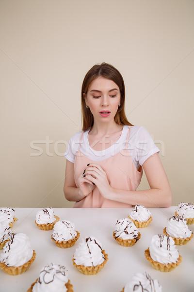 концентрированный молодые Lady сидят позируют Сток-фото © deandrobot