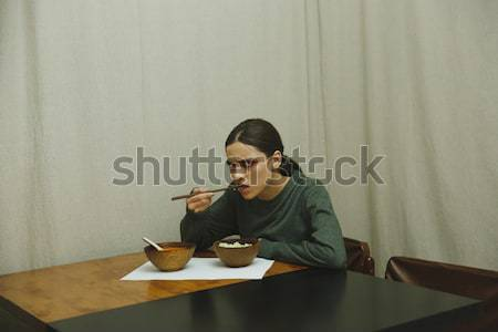 Side view of pensive woman by the table Stock photo © deandrobot