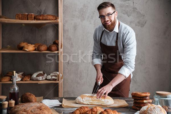 Boldog fiatalember pék áll pékség vág Stock fotó © deandrobot
