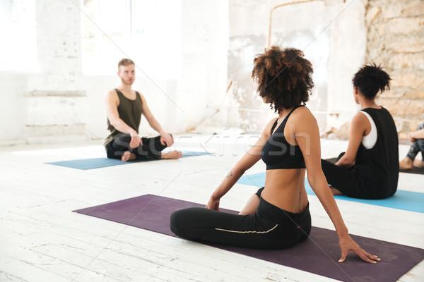 Grupo multicultural jóvenes yoga estudio Foto stock © deandrobot