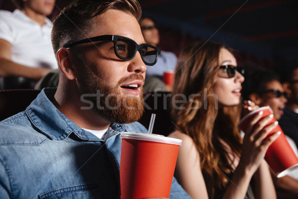 Concentrated loving couple friends sitting in cinema Stock photo © deandrobot