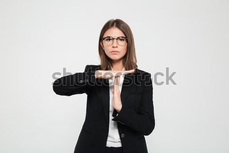 Portrait of a serious young businesswoman in eyeglasses Stock photo © deandrobot