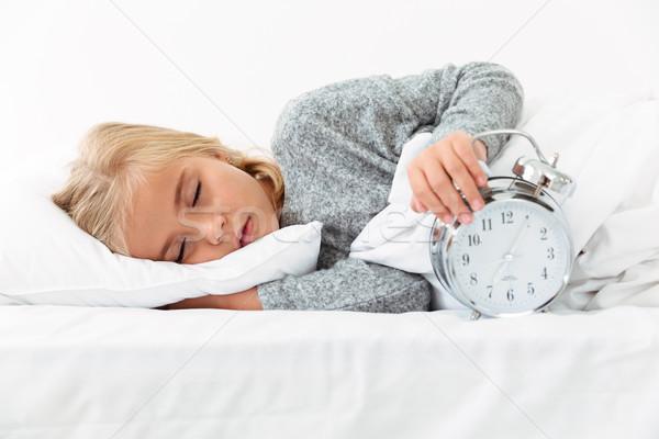 Close-up portrait of sleeping kid holding alarm clock Stock photo © deandrobot