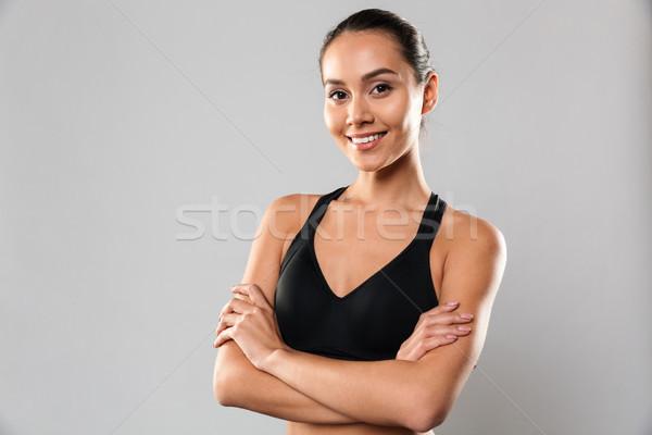 Deportes mujer posando los brazos cruzados imagen asombroso Foto stock © deandrobot