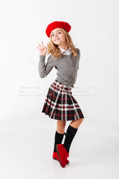 Full length portrait of a cute little schoolgirl Stock photo © deandrobot