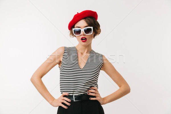 Portrait of a stylish woman wearing red beret Stock photo © deandrobot