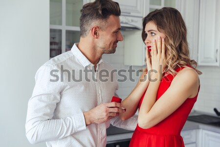 Portrait of a handsome man proposing to his lovely girlfriend Stock photo © deandrobot
