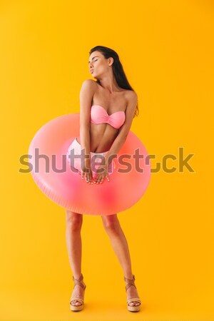Back view of young girl in swimsuit Stock photo © deandrobot