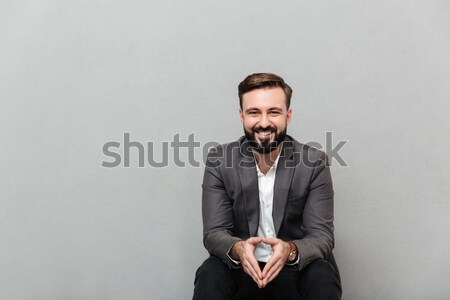 Cropped portrait of relaxed man resting while sitting on chair i Stock photo © deandrobot