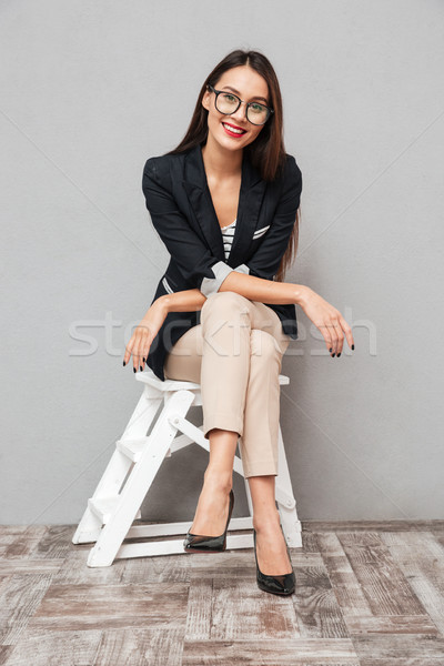 Pionowy obraz zadowolony asian business woman okulary Zdjęcia stock © deandrobot