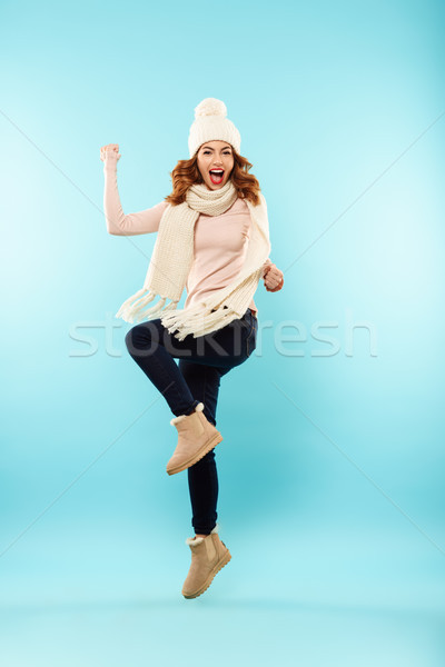 Full length portrait of a cheery young girl Stock photo © deandrobot