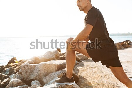 Cropped image of handsome sportsman Stock photo © deandrobot