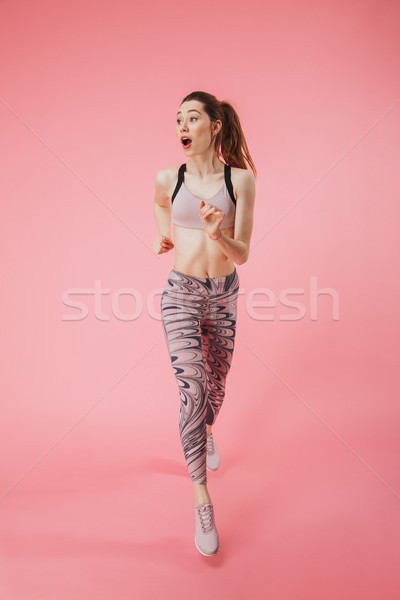 Stock photo: Shocked young fitness sports woman running