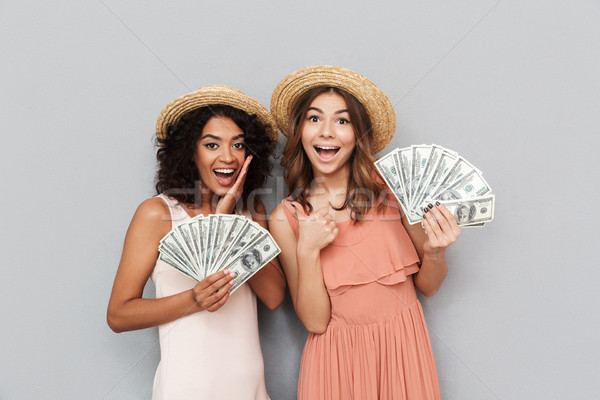 Portrait of two successful multiethnic women, caucasian and afri Stock photo © deandrobot