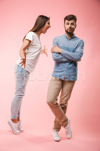 Full length portrait of a furious young couple Stock photo © deandrobot
