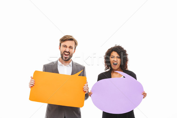 Portrait of a furious young business couple Stock photo © deandrobot