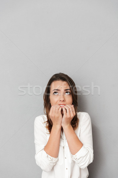 Portré aggódó fiatal üzletasszony harap körmök Stock fotó © deandrobot
