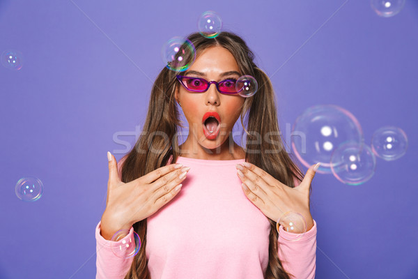 Portrait of excited teen woman with two ponytails in sweatshirt  Stock photo © deandrobot