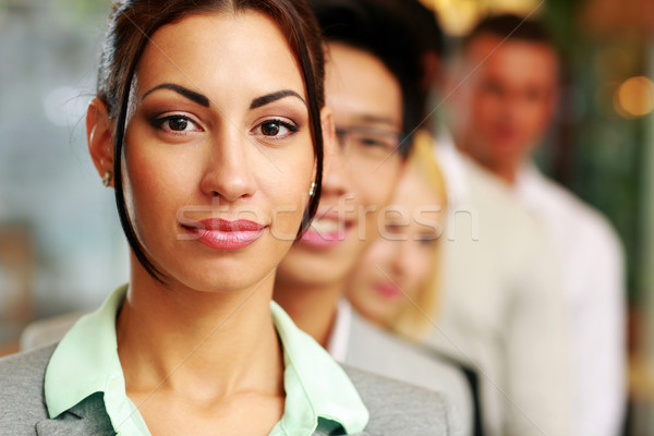 Group of business people in the office lined up Stock photo © deandrobot