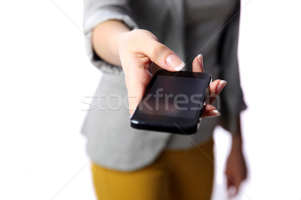 Woman passing smartphone to you isolated on white background Stock photo © deandrobot