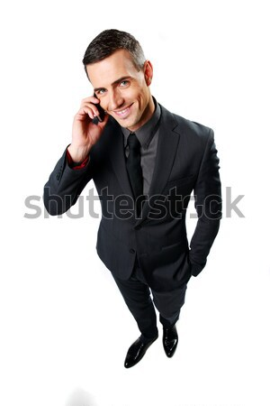 Happy businessman speaking on cell phone isolated on a white background Stock photo © deandrobot