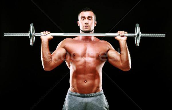 Muskularny człowiek sztanga czarny ciało Zdjęcia stock © deandrobot